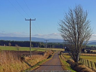 Image of minor road and Ben Wyvis.